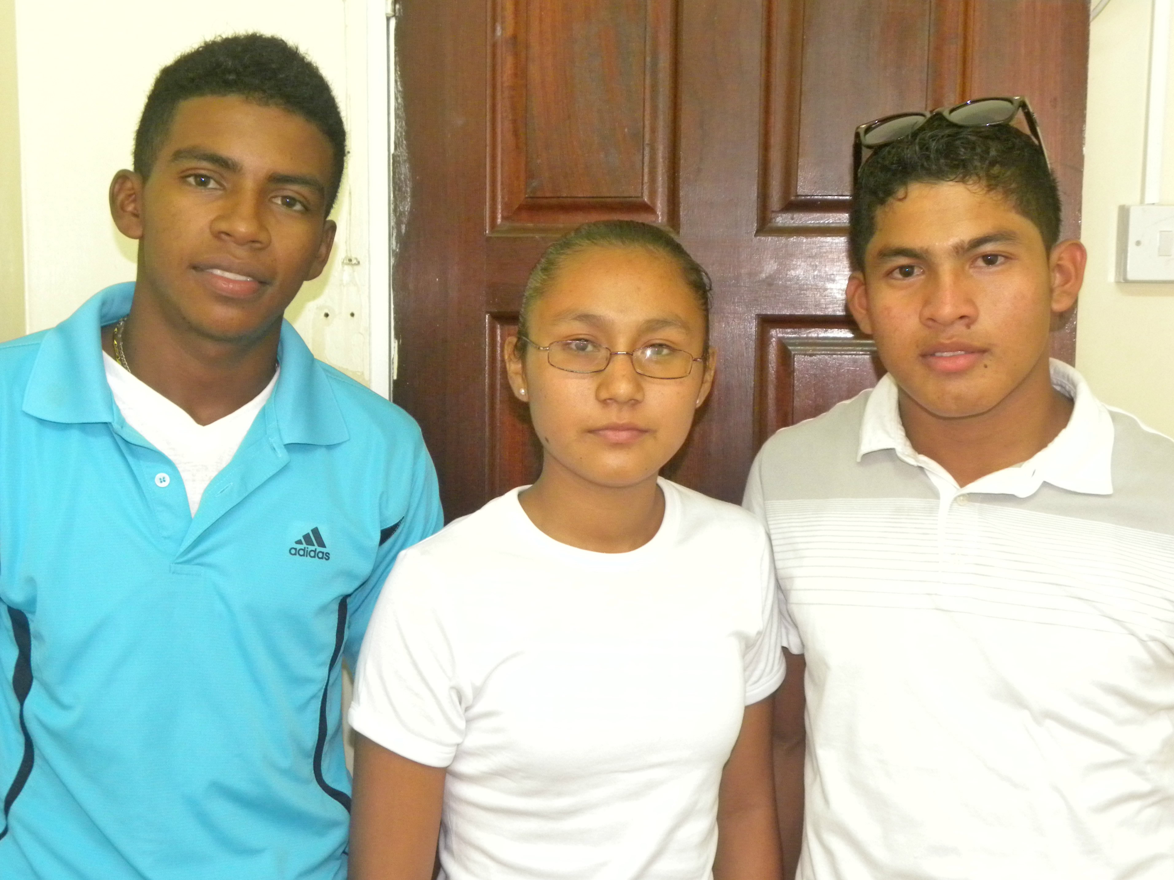 (Left to right) Andrew Abbensetts, Esther Eusebio, and Kenroy Robinson will participate in a four year apprenticeship programme with the Guyana Power and Light Inc.